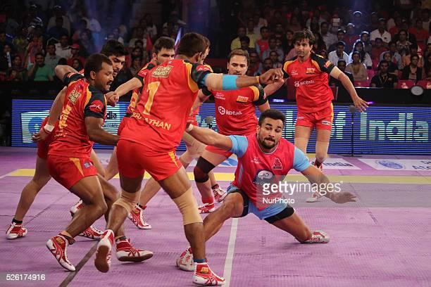 Players of Jaipur Pink Panthers and Bengaluru Bulls kabaddi team in action during the Pro Kabaddi League match at Sawai Mansingh Indoor stadium in...