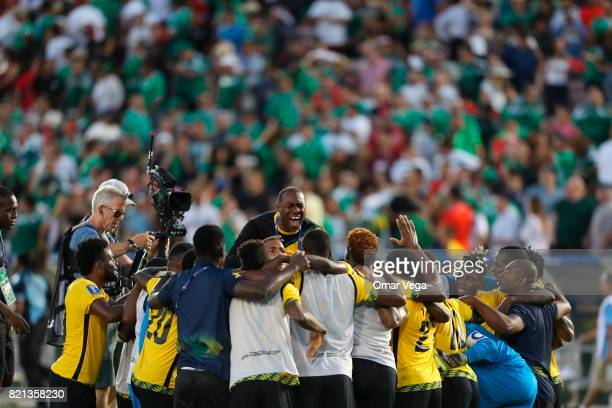Players of Jamaica celebrate after qualifying to the final during a match between Mexico and Jamaica as part of CONCACAF Gold Cup Semifinal at Rose...