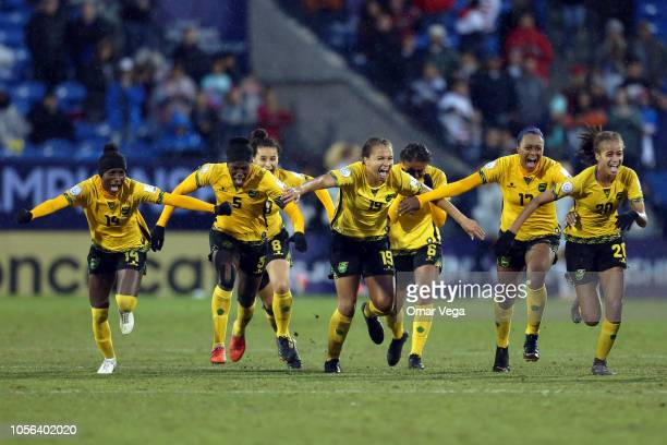 Players of Jamaica celebrate after winning a match between Panama and Jamaica as part of CONCACAF Women's Championship at Toyota Stadium on October...