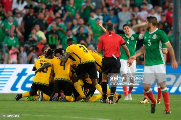 Players of Jamaica celebrate the goal scored by Kemar Lawrence during a match between Mexico and Jamaica as part of CONCACAF Gold Cup Semifinal at...