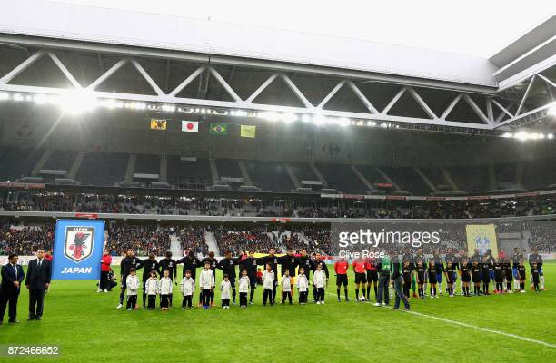 Players of Japan and Brazil line up prior to the international friendly match between Brazil and Japan at Stade PierreMauroy on November 10 2017 in...