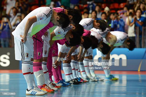 Players of Japan are looking dejected after loosing during the FIFA Futsal World Cup Round of 16 match between Ukraine and Japan at Indoor Stadium...