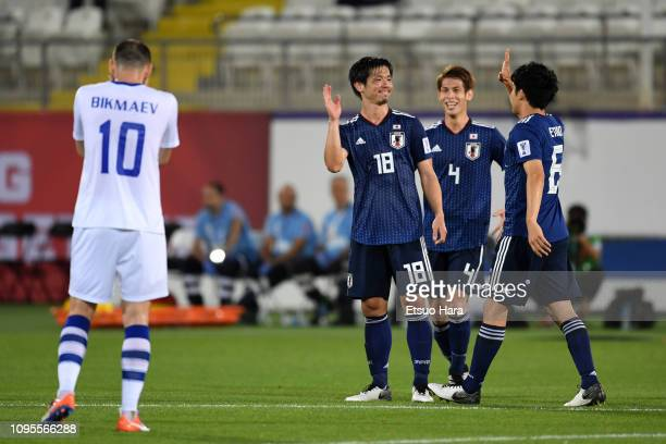 Players of Japan celebrate 21 victory at the end of the AFC Asian Cup Group F match between Japan and Uzbekistsn at Khalifa Bin Zayed Stadium on...