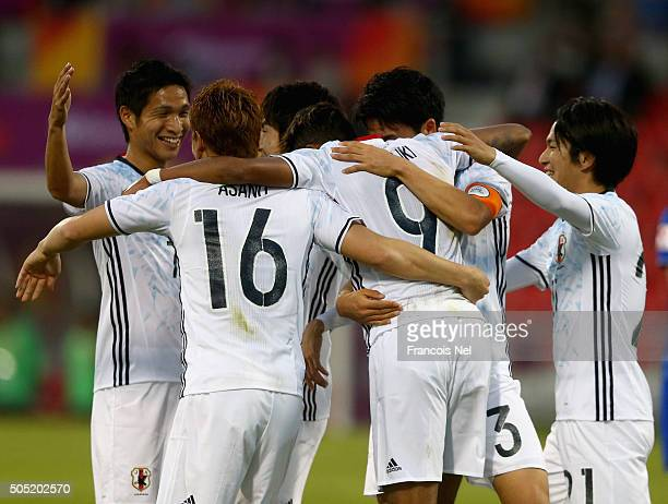 Players of Japan celebrate after Musashi Suzuki of Japan scores a goal during the AFC U23 Championship Group B match between Thailand and Japan at...