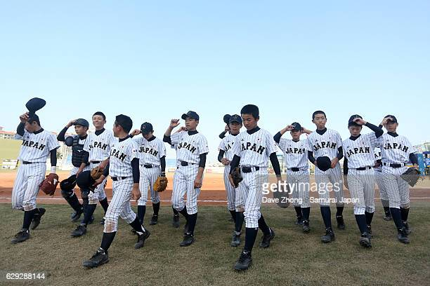 Players of Japan celebrate after winning the 2016 lX BFA U12 Baseball Championship semifinal game between Japan and China at on December 12 2016 in...
