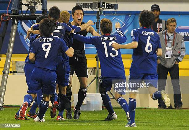 Players of Japan celebrate after winning the penalty shoot out during the AFC Asian Cup Semi Final match between Japan and South Korea at AlGharafa...