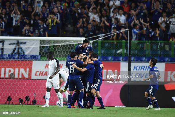 Players of Japan celebrate scoring a goal during the international friendly match between Japan and Costa Rica at Suita City Football Stadium on...
