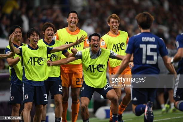 Players of Japan celebrate the first goal by Yuya Osako during the AFC Asian Cup semi final match between Iran and Japan at Hazza Bin Zayed Stadium...