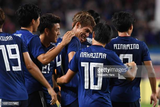 Players of Japan celebrate the first goal during the international friendly match between Japan and Costa Rica at Suita City Football Stadium on...