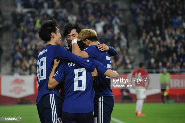 Players of Japan celebrate the first goal during the international friendly match between Japan and Bolivia at Noevir Stadium Kobe on March 26 2019...