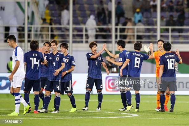 Players of Japan celebrate the victory after the AFC Asian Cup Group F match between Japan and Uzbekistsn at Khalifa Bin Zayed Stadium on January 17...