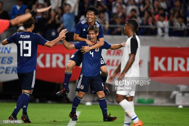 Players of Japan celebrate their side's first goal during the international friendly match between Japan and Costa Rica at Suita City Football...