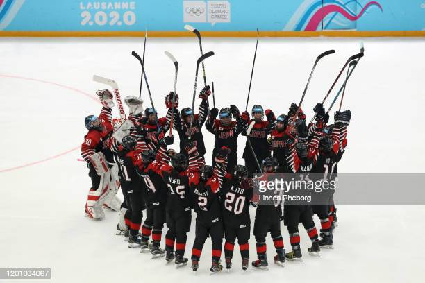 Players of Japan celebrate victory following the Women's 6-Team Ice Hockey Tournament Finals Gold Medal Game between Japan and Sweden on day 12 of...