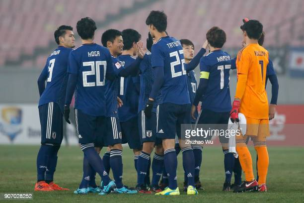 Players of Japan encourage each other during AFC U23 Championship Quarterfinal between Japan and Uzbekistan at Jiangyin Sports Center on January 19...