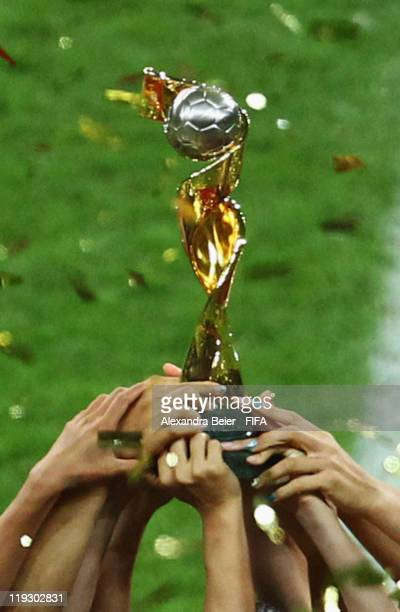 Players of Japan hold up the trophy as they celebrate their victory of the FIFA Women's World Cup Final match between Japan and USA at the FIFA World...