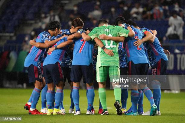 Players of Japan huddle prior to FIFA World Cup Asian Qualifier Final Round Group B match between Japan and Oman at Panasonic Stadium Suita on...