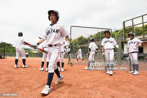 Players of Japan huddle prior to the BFA U12 Asian Championship Group A match between Sri Lanka and Japan at Xinsheng Park Baseball Field on August...