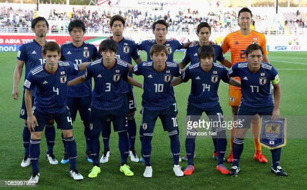 Players of Japan line up for a team photo prior to the AFC Asian Cup Group F match between Japan and Uzbekistsn at Khalifa Bin Zayed Stadium on...