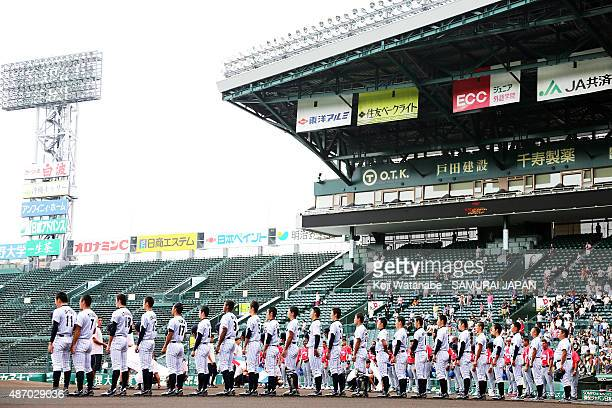 Players of Japan line up for national anthemin the super round game between Japan v Cuba during the 2015 WBSC U-18 Baseball World Cup at the Koshien...