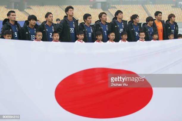 Players of Japan line up for team photos prior to AFC U23 Championship Quarterfinal between Japan and Uzbekistan at Jiangyin Sports Center on January...