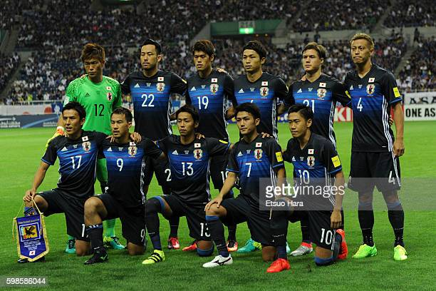 Players of Japan line up for team photos prior to the 2018 FIFA World Cup Qualifiers Group B match between Japan and United Arab Emirates at Saitama...