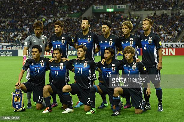 Players of Japan line up for team photos prior to the 2018 FIFA World Cup Qualifiers match between Japan and Iraq at Saitama Stadium on October 6...