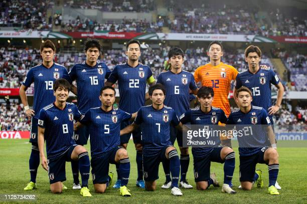 Players of Japan line up for team photos prior to the AFC Asian Cup semi final match between Iran and Japan at Hazza Bin Zayed Stadium on January 28...