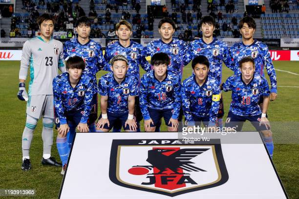 Players of Japan line up for team photos prior to the EAFF E1 Football Championship match between Japan and Hong Kong at Busan Gudeok Stadium on...