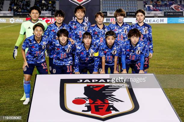 Players of Japan line up for team photos prior to the EAFF E-1 Football Championship match between South Korea and Japan at Busan Gudeok Stadium on...