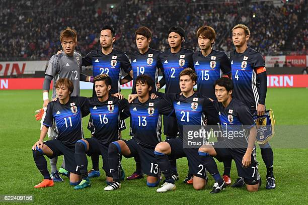 Players of Japan line up for team photos prior to the international friendly match between Japan and Oman at Kashima Soccer Stadium on November 11,...