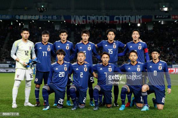 Players of Japan line up for team photos prior to the match of the EAFF E1 Men's Football Championship between Japan and North Korea at Ajinomoto...