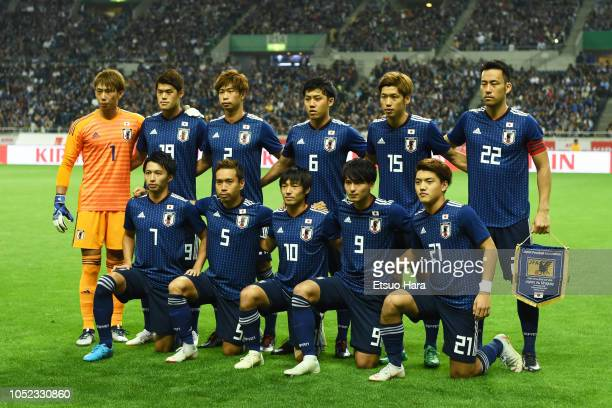 Players of Japan line up for the team photo prior to the international friendly match between Japan and Uruguay at Saitama Stadium on October 16 2018...