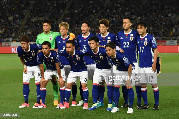 Players of Japan line up for the team photos prior to the international friendly match between Japan and Syria at Tokyo Stadium on June 7 2017 in...