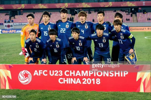 Players of Japan line up prior to the AFC U23 Championship Group B match between Japan and Palestine at Jiangyin Sports Center on January 10 2018 in...