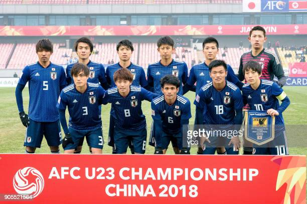 Players of Japan line up prior to the AFC U-23 Championship Group B match between Japan and North Korea at Jiangyin Stadium on January 16, 2018 in...