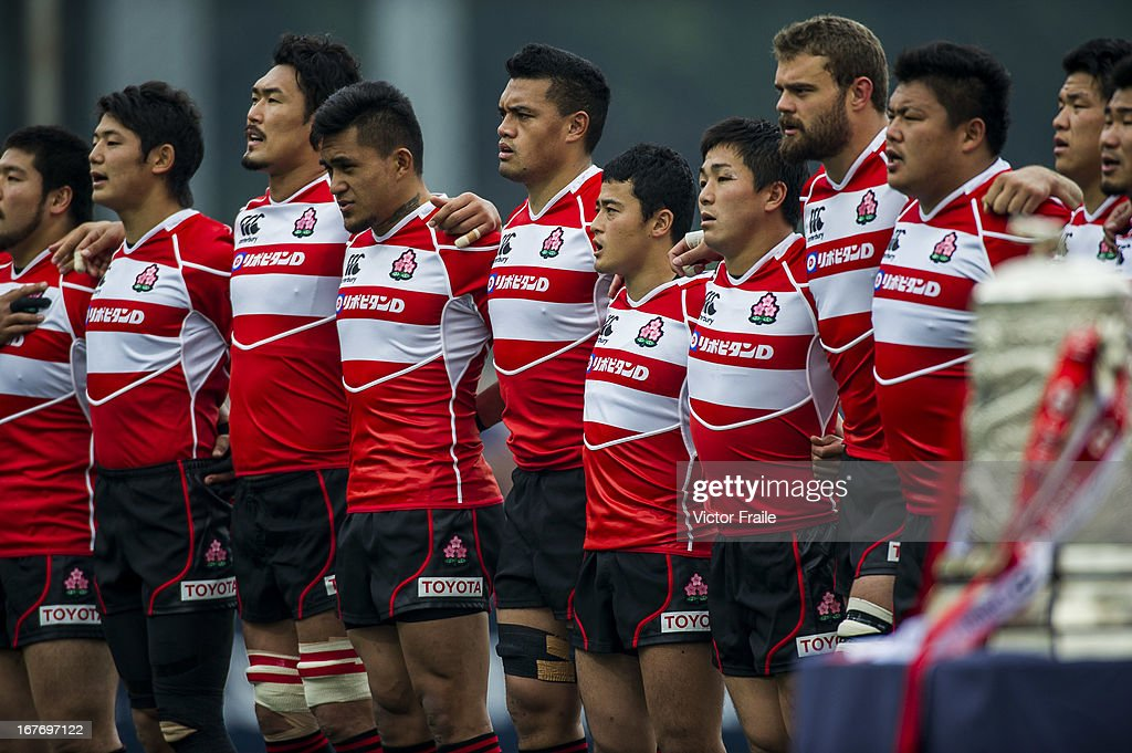 Players of Japan listen to their national anthem before their Asian 5 Nations Top 5 Division match against Hong Kong at the Hong Kong Football CLub on April 27, 2013 in Hong Kong, China.