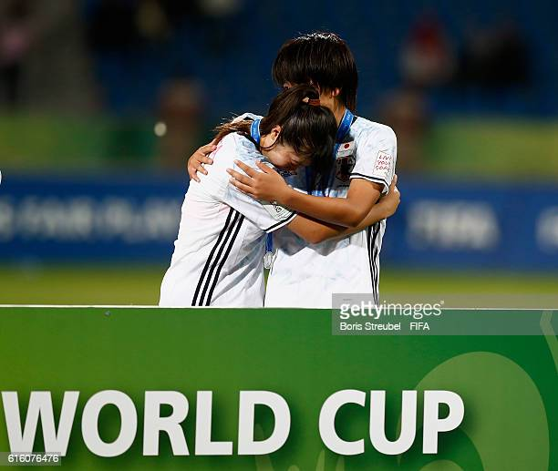 Players of Japan look dejected after losing the FIFA U17 Women's World Cup Finale match between Korea DPR and Japan at Amman International Stadium on...