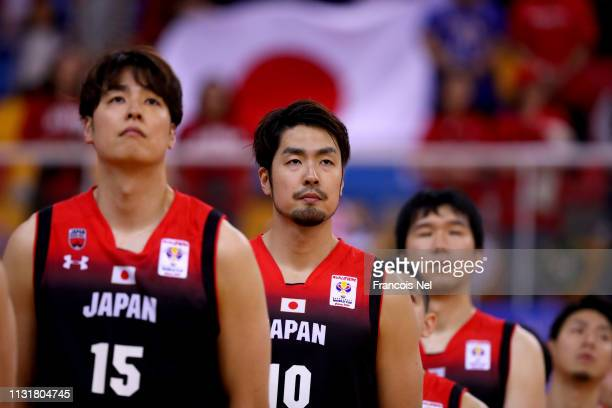 Players of Japan look on during the national anthem prior to the start of the FIBA World Cup Asian Qualifier match between Qatar and Japan on...