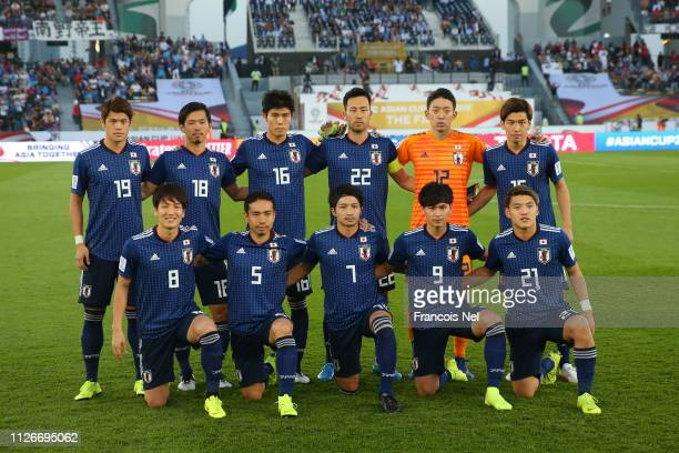 Players of Japan pose for a team photo prior to the AFC Asian Cup final match between Japan and Qatar at Zayed Sports City Stadium on February 01,...