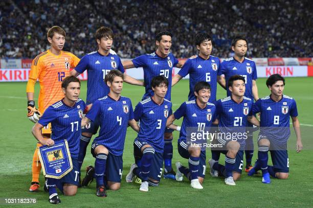 Players of Japan pose for a team photo prior to the international friendly match between Japan and Costa Rica at Suita City Football Stadium on...