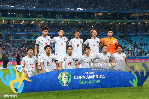 Players of Japan pose for a team photograph ahead the Group C match between Uruguay and Japan during Copa America Brazil 2019 at Arena do Gremio...