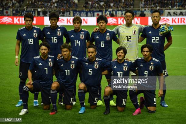 Players of Japan pose for phtograph the FIFA World Cup Asian Qualifier second round match between Japan and Mongolia at Saitama Stadium on October...