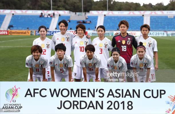 Players of Japan pose for the team photograph during the AFC Women's Asian Cup Group B match between South Korea and Japan at the Amman International...