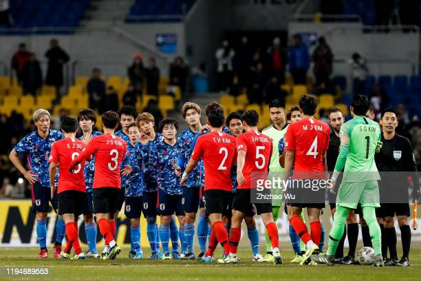 Players of japan shake hand with players of South Korea after the EAFF E-1 Football Championship match between South Korea and Japan at Busan Asiad...