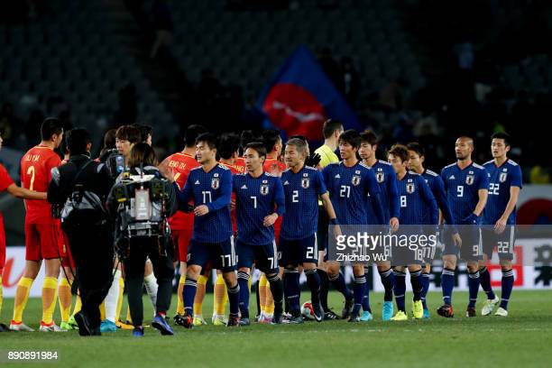 Players of Japan shake hands with Chines players after the EAFF E1 Men's Football Championship match between Japan and China at Ajinomoto Stadium on...