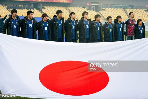 Players of Japan sing the national anthem prior to the AFC U-23 Championship Group B match between Japan and North Korea at Jiangyin Stadium on...