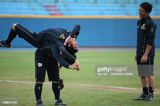 Players of Japan stretch during a Japan team training session at Taichung Baseball Stadium on November 12 2014 in Taichung Taiwan