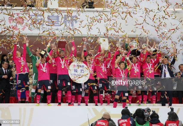 Players of Japanese JLeague club Cerezo Osaka celebrate their victory over the Yokohama F Marinos during the awards ceremony after the Emperor's Cup...