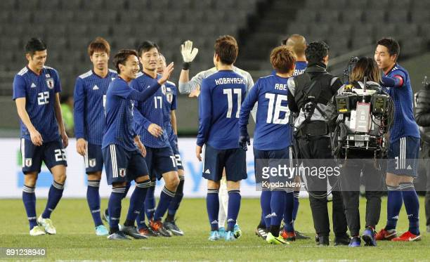 Players of Japan's national team celebrate after defeating China 21 in an E1 Football Championship match at Ajinomoto Stadium in Chofu Tokyo on Dec...
