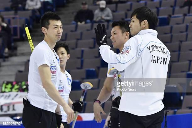 Players of Japan's SC Karuizawa Tetsuro Shimizu Kosuke Morozumi Tsuyoshi Yamaguchi and Yusuke Morozumi celebrate after beating Russia 124 at the...